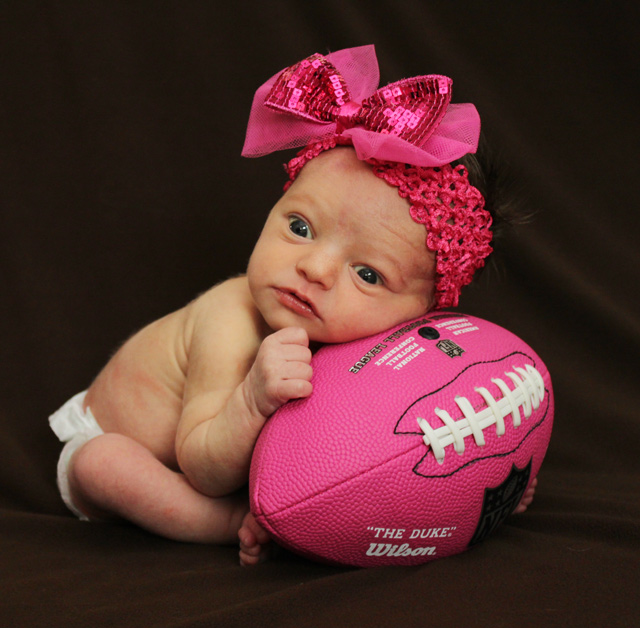 girl newborn photos pink football