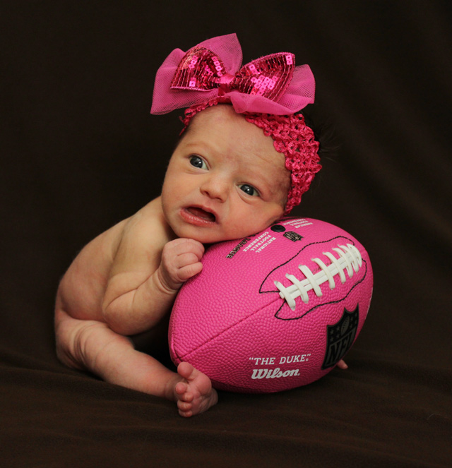 girl newborn photos football
