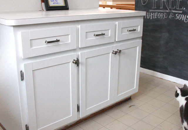 kitchen cabinet trim. The only thing left to do  for the cabinets is adding wood trim onto this fake drawer in front of sink which means my dad has come over and Kitchen Cabinet Update Drew Vanessa